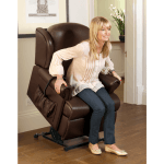 Lady sitting in her Sherborne Malvern leather recliner